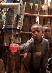 Child drinks from a well in Ethiopia