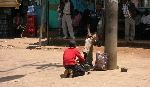 A boy shines shoes in Ethiopia