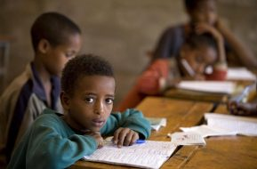 © UNICEF/NYHQ2009-2295/Holt Ethiopia, 2009 - Boys attend class at Imdibir Secondary School in the town of Imdibir.