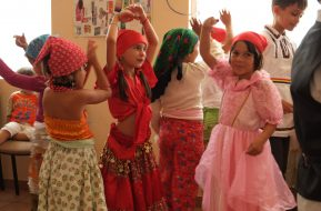 Cultural dance performance by children dressed traditional outfit