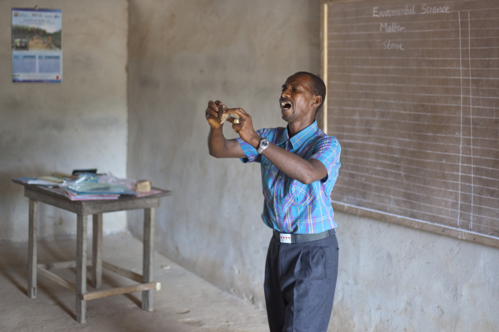 Mr. Ibrahim Koroma teaching matter in the science class at DEC Primary School in Buya village - by Martin Nordin