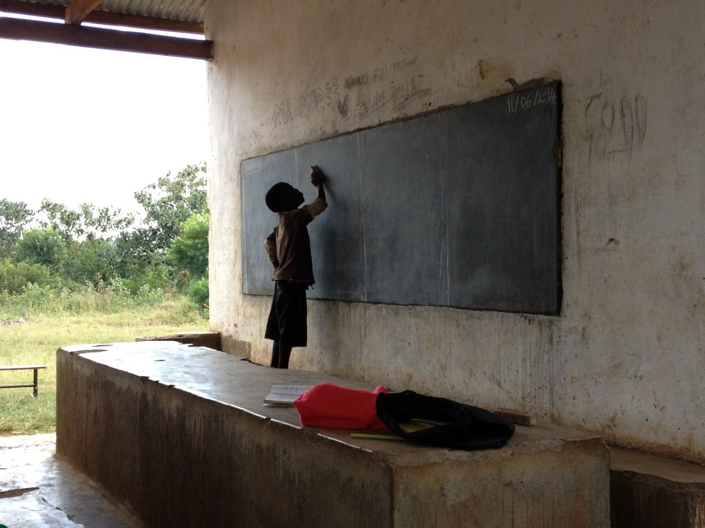 Boy in front of class in outside classroom at the Nthulo Primary school - By Marlies Davids