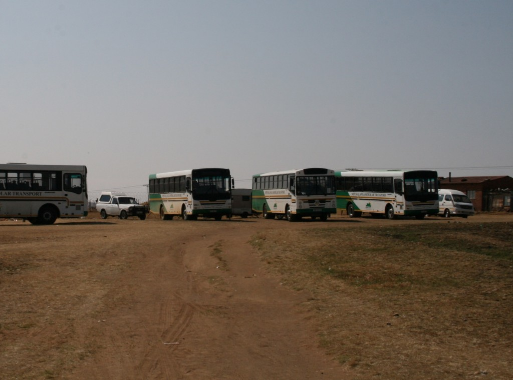 School buses lined up in the school yard at Umfudlana Combined School, Mpumalanga. Photographer: Mike Creevy