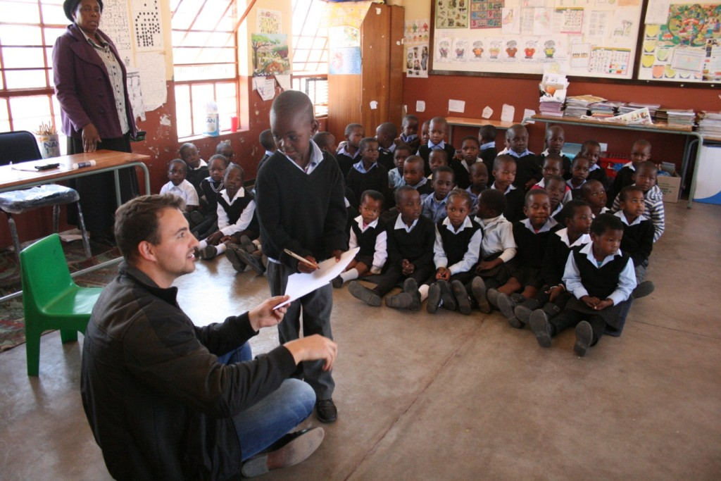 A child from Grade R shows Ben from UNICEF SA his drawing skills - by Mike Creevy