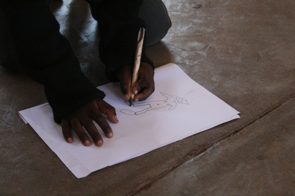 A child from grade R draws a happy child for us - by Mike Creevy