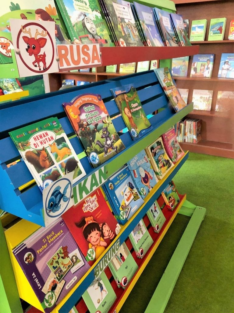Colourful bookshelves and books in the new school library
