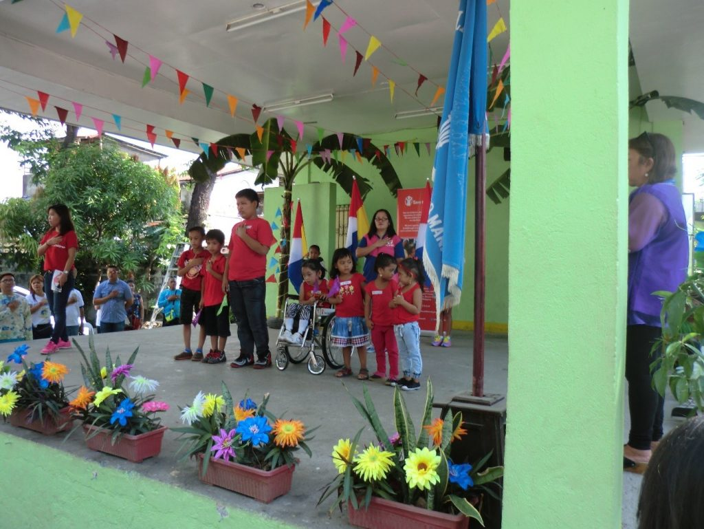 The children with disabilities singing the Philippines' national anthem. Photograph by Nick van Kampen