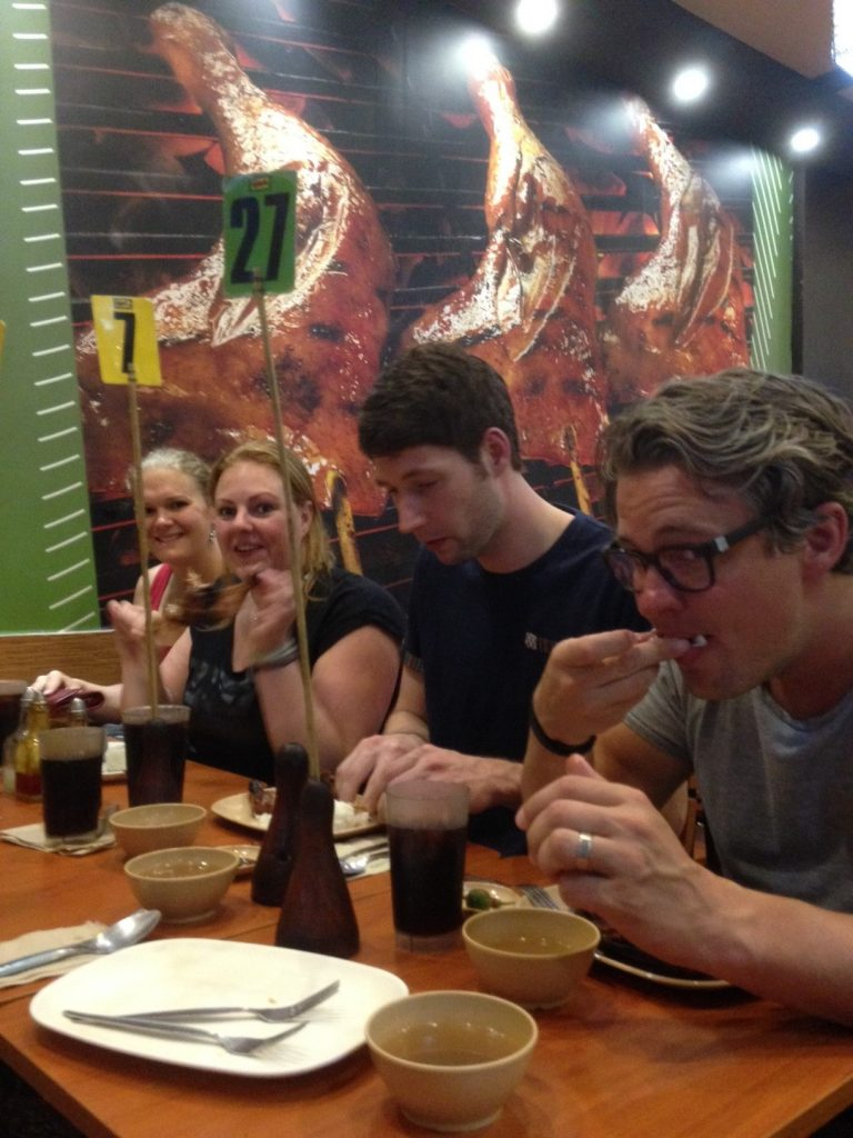 Title: Local food at Mang Inasal In the picture: Wendy, Marieke, Nick and Niclas. Picture by Elise Jeronimus.