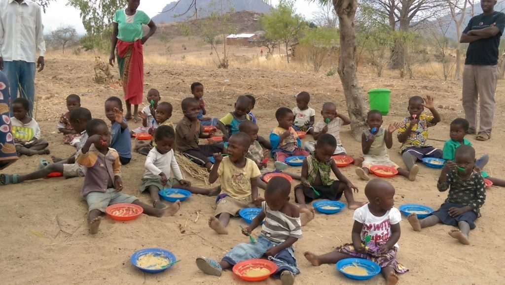 20 September 2016. Kids at the Tadala childcare centre near Blantyre, Malawi, eat porridge for lunch. For many kids, it is the only meal of the day—one of the reasons why parents send their kids to school. Photo by Kay Sousa