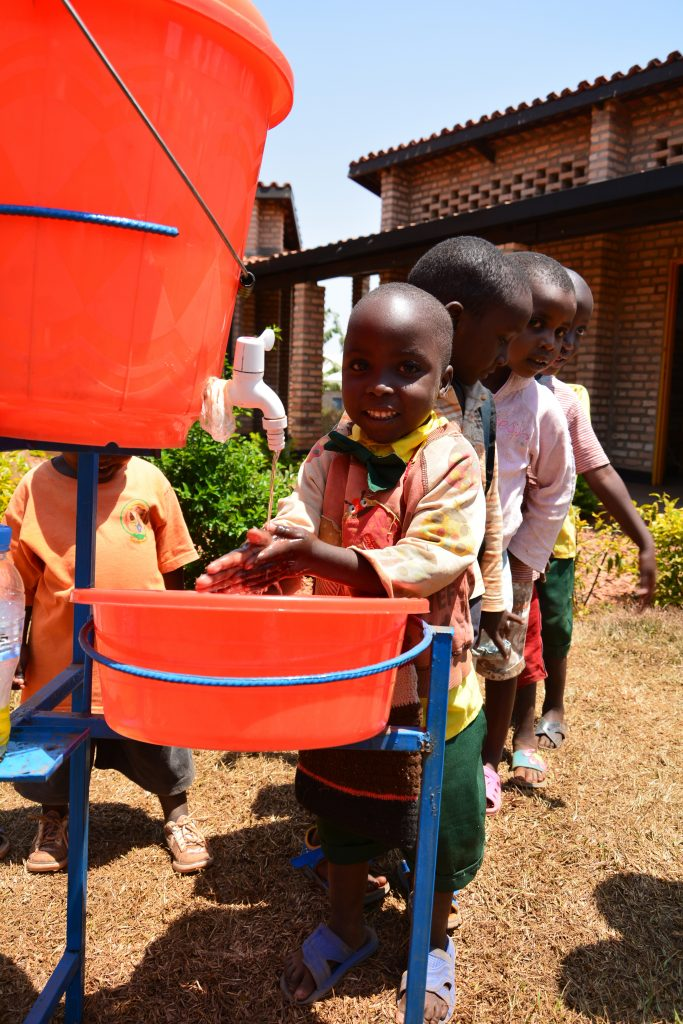 Emmelyne, a four-year-old girl from Rwamagana District, learns the importance of washing hands after using the toilet and before eating porridge. © UNICEF Rwanda/2016/Park