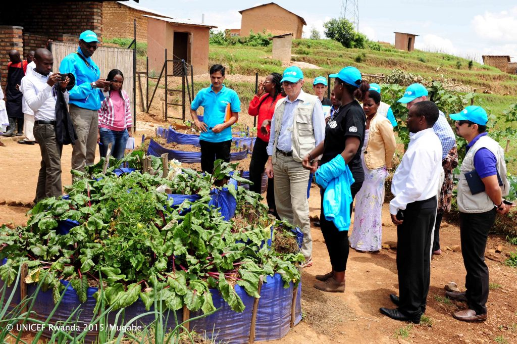 Per Heggenes, CEO of the IKEA Foundation, sees the kitchen garden and learns of its nutritional benefits for children at the Miyove ECD centre in Gicumbi district.