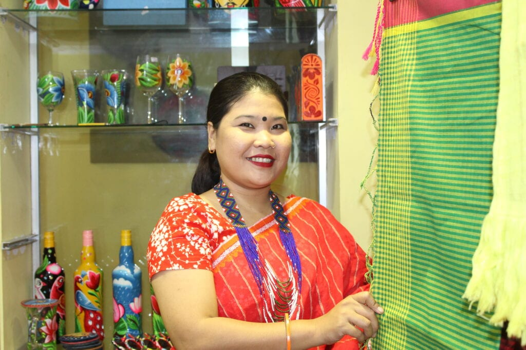Woman entrepreneur showing her products in her shop